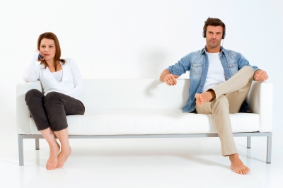 Separated Couple On Sofa